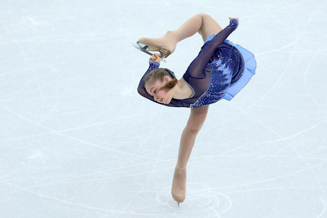 SOCHI, RUSSIA - FEBRUARY 08: Yulia Lipnitskaya of Russia competes in the Figure Skating Team Ladies Short Program during day one of the Sochi 2014 Winter Olympics at Iceberg Skating Palace on February 8, 2014 in Sochi, Russia. (Photo by Matthew Stockman/Getty Images)