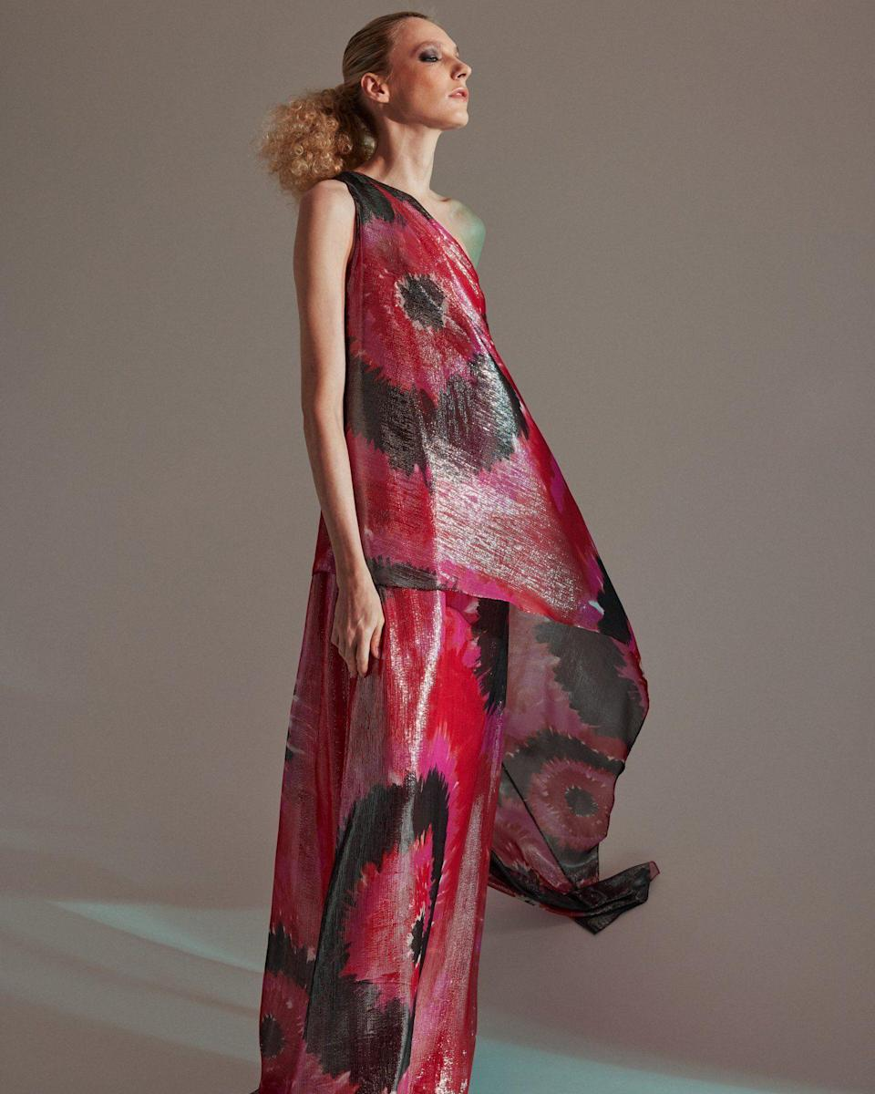 """<p><strong>Halston</strong></p><p>halston.com</p><p><strong>$1595.00</strong></p><p><a href=""""https://go.redirectingat.com?id=74968X1596630&url=https%3A%2F%2Fhalston.com%2Fcollections%2Fhalston-x-netflix-capsule%2Fproducts%2Fhalston-beverly-printed-lurex-gown-fuchsia-red&sref=https%3A%2F%2Fwww.townandcountrymag.com%2Fstyle%2Ffashion-trends%2Fg36651434%2Fshop-netflix-halston-clothes%2F"""" rel=""""nofollow noopener"""" target=""""_blank"""" data-ylk=""""slk:Shop Now"""" class=""""link rapid-noclick-resp"""">Shop Now</a></p>"""