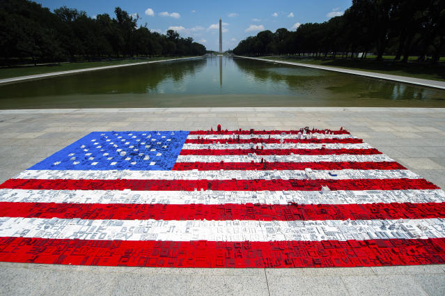 A 16 ft wide by 31 ft long LEGO® mural of an American flag, built by National Mall visitors is situated on the Lincoln Memorial plaza in support of The Trust for the National Mall event, Monday, July 2 in Washington (Joy Asico/AP Images for The LEGO Group)
