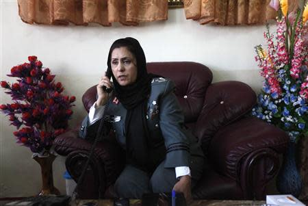 Colonel Bayaaz talks on the phone at her office before an interview in Kabul