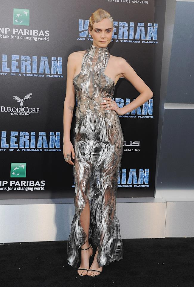 <p>The model-turned-actress majorly turned heads in a futuristic silver gown by Iris van Herpen.<br /><i>[Photo: Getty]</i> </p>