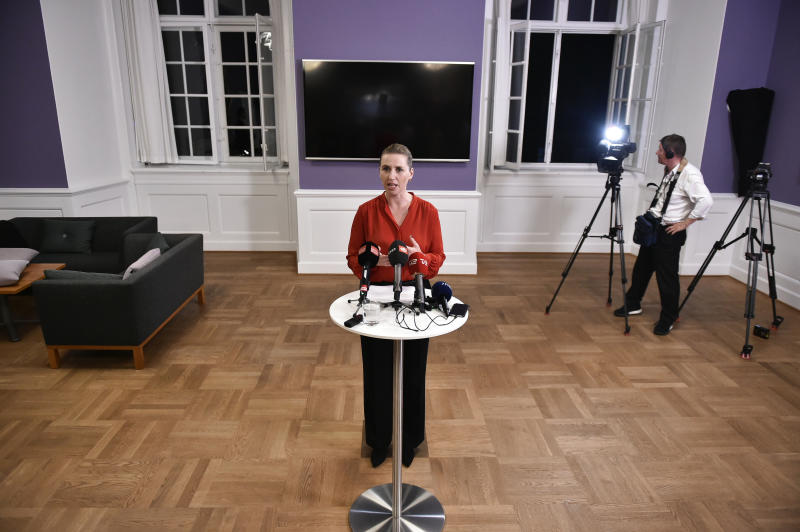Mette Frederiksen of The Danish Social Democrats addresses the media after finalizing the government negotiations shortly after midnight at Christiansborg Castle in Copenhagen, Denmark, early Wednesday June 26, 2019.  Frederiksen announced that The Danish Social Democrats will form a minority government backed by three other left-wing parties. (Mads Claus Rasmussen/Ritzau Scanpix via AP)
