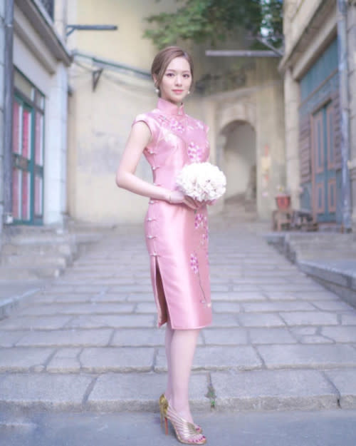 Crystal welcomed the Year of the Ox in ravishing red and demure pink