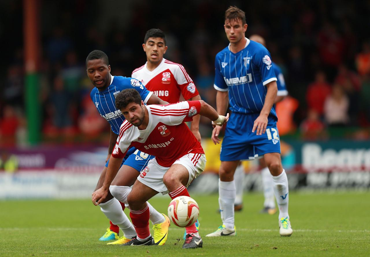 Swindon's Yaser Kasim gets away from Gillingham's Antonio German during the Sky Bet Football League One match at the County Ground, Swindon.