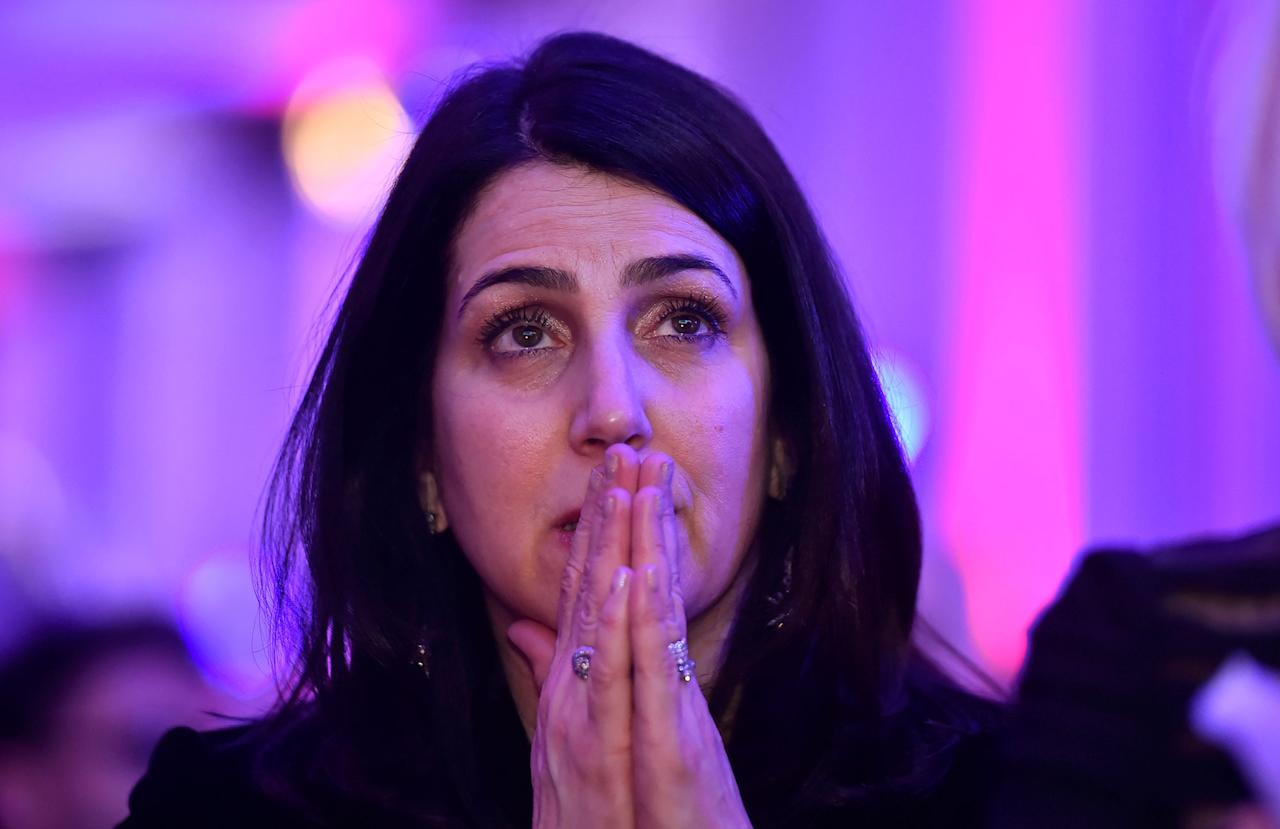 <p>A woman reacts to the television coverage of U.S. presidential election results during an election party at the U.S. embassy in London, Britain on Nov. 9, 2016. (Photo: Hannah McKay/Reuters) </p>