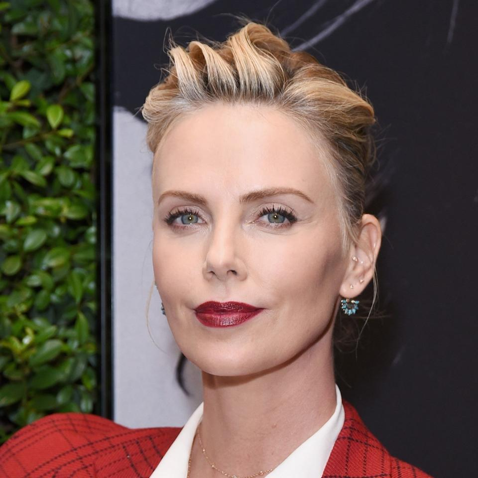 "If anyone consistently nails a short-hair updo, it's <a href=""https://www.allure.com/topic/charlize-theron?mbid=synd_yahoo_rss"">Charlize Theron</a>, and this hairstyle is no exception. Her soft mohawk shows off pretty blonde highlights that still have a bit of an edge. To get that killer height on top, stylist <a href=""https://www.instagram.com/stizzyho/"">Stacy Ho</a> at Méche Salon in Beverly Hills recommends using a flat brush to sweep hair from the left side all the way to the center of the back of the head and secure with bobby pins. Then, pull the opposite side back and secure it all. ""When you're done, it'll look like a big puff of hair pushing up and to the right,"" she says. Feel free to pull a few of the pieces up if you want extra volume."