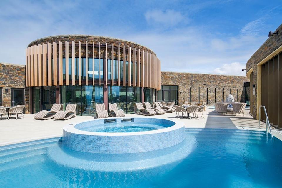 """<p>Nabbing an exclusive spot on a clifftop overlooking Fistral Beach, the Headland Hotel is truly one of the UK's top luxury spa destinations. The state-of-the-art spa boasts sweeping coastal views, and you can even wander straight down to the beach for a some fresh sea air after a restorative massage.</p><p>Steeped in history, over the years it's had royal visitors (hello, Prince Charles) and attracted Hollywood big-hitters (The Witches was filmed here in 1987). Its stylish, modern interiors are split between the Victorian house and several chic self-catering cottages.</p><p>The spa is a haven of tranquility, with low-lit treatment rooms and a choice of indoor and outdoor pools. And foodies will be happy with the fresh sea-to-spoon delights in the three restaurants.</p><p><strong>Covid-19 update:</strong> Steam rooms and saunas are closed.</p><p><a href=""""https://www.redescapes.com/offers/cornwall-newquay-headland-hotel"""" rel=""""nofollow noopener"""" target=""""_blank"""" data-ylk=""""slk:Read our review of The Headland Hotel & Spa."""" class=""""link rapid-noclick-resp"""">Read our review of The Headland Hotel & Spa.</a></p><p><a class=""""link rapid-noclick-resp"""" href=""""https://go.redirectingat.com?id=127X1599956&url=https%3A%2F%2Fwww.booking.com%2Fhotel%2Fgb%2Fthe-headland.en-gb.html%3Faid%3D2070929%26label%3Dluxury-spa-hotels-uk&sref=https%3A%2F%2Fwww.redonline.co.uk%2Ftravel%2Finspiration%2Fg34573730%2Fluxury-spa-hotels-uk%2F"""" rel=""""nofollow noopener"""" target=""""_blank"""" data-ylk=""""slk:CHECK AVAILABILITY"""">CHECK AVAILABILITY</a></p>"""