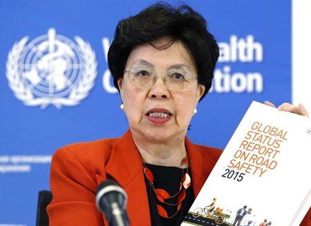 WHO Director-General Chan holds the Global Status Report on Road Safety 2015 during a news conference in Geneva