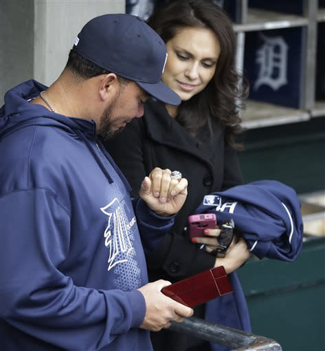 Detroit Tigers relief pitcher Octavio Dotel looks over his American League championship ring presented before the Tigers' baseball game against the New York Yankees in Detroit, Saturday, April 6, 2013. (AP Photo/Carlos Osorio)