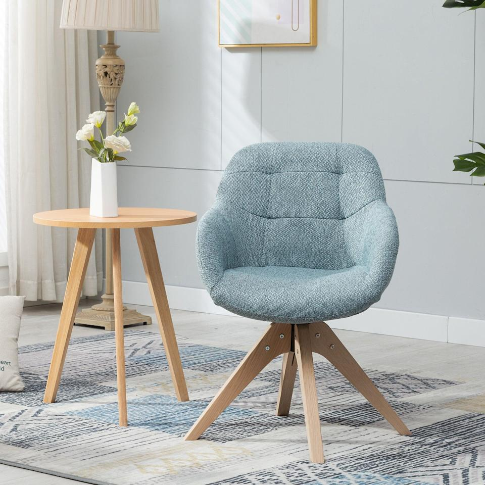 "<br><br><strong>Corrigan Studio</strong> Giacchetto Swivel Armchair, $, available at <a href=""https://go.skimresources.com/?id=30283X879131&url=https%3A%2F%2Fwww.wayfair.com%2Ffurniture%2Fpdp%2Fcorrigan-studio-giacchetto-swivel-armchair-w003517057.html"" rel=""nofollow noopener"" target=""_blank"" data-ylk=""slk:Wayfair"" class=""link rapid-noclick-resp"">Wayfair</a>"