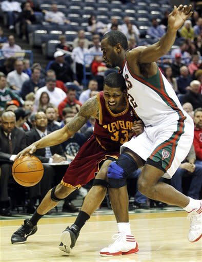 Cleveland Cavaliers' Alonzo Gee (33) drives against Milwaukee Bucks' Luc Mbah a Moute, right, during the first half of an NBA basketball game, Wednesday, April 4, 2012, in Milwaukee. (AP Photo/Jeffrey Phelps)