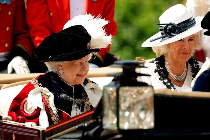 The Queen and Duchess of Cornwall leave in a carriage after attending the Most Noble Order of the Garter Ceremony (AFP/Getty Images)
