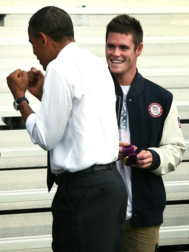 WASHINGTON, DC - SEPTEMBER 14: U.S. President Barack Obama (L) talks to 2012 Olympic diving gold medalist David Boudia during a South Lawn event to welcome the 2012 U.S. Olympic and Paralympic teams September 14, 2012 at the White House in Washington, DC. Vice President Joseph Biden and first lady Michelle Obama joined the president to host the athletes and honor their participation and success in this year's Olympic and Paralympic Games in London. (Photo by Alex Wong/Getty Images)