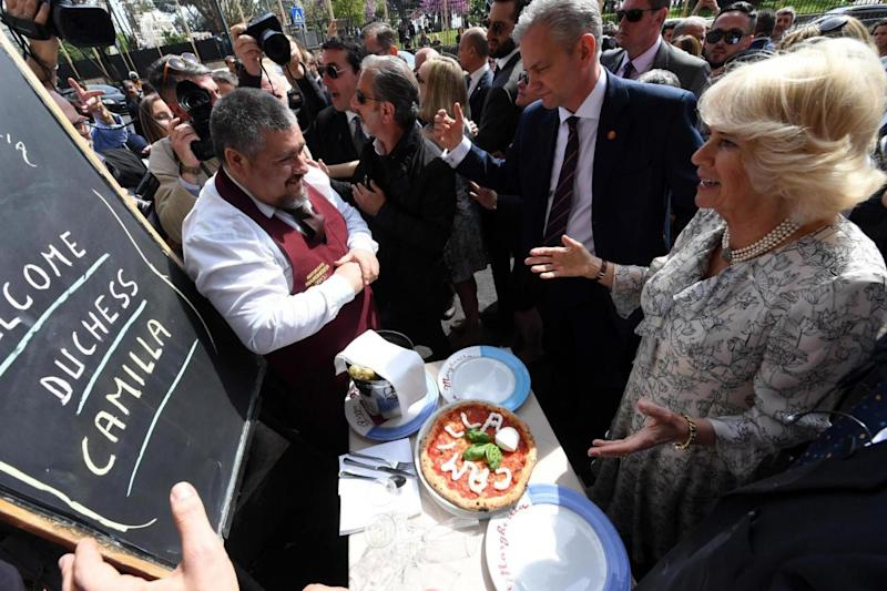 Camilla, the Duchess of Cornwall, is welcomed in Naples with a special pizza dedicated to her (EPA)