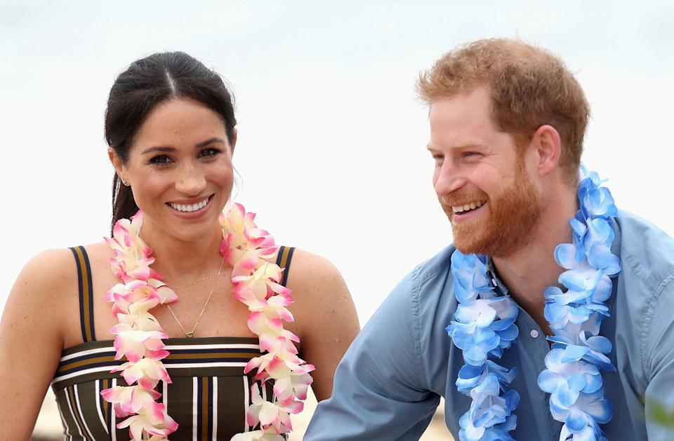 Prince Harry, Duke of Sussex and Meghan, Duchess of Sussex talk to members of OneWave, an awareness group for mental health and wellbeing at South Bondi Beach on October 19, 2018 in Sydney, Australia. The Duke and Duchess of Sussex are on their official 16-day Autumn tour visiting cities in Australia, Fiji, Tonga and New Zealand. Chris Jackson/Pool via REUTERS