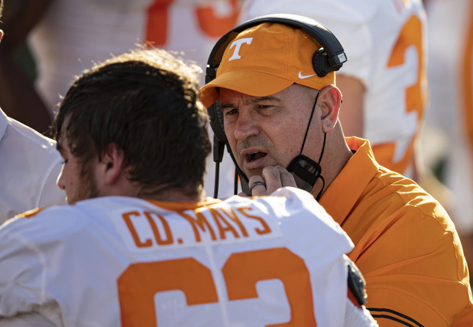 Tennessee head coach Jeremy Pruitt, right, talks with offensive lineman Cooper Mays (63) during the first half of an NCAA college football game against Vanderbilt, Saturday, Dec. 12, 2020, in Nashville, Tenn. (AP Photo/Wade Payne)