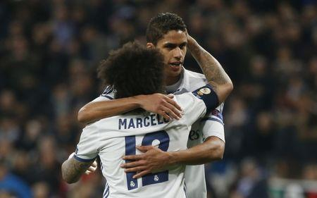 Football Soccer - Real Madrid v Napoli - UEFA Champions League Round of 16 First Leg - Estadio Santiago Bernabeu, Madrid, Spain - 15/2/17 Real Madrid's Marcelo and Raphael Varane Reuters / Susana Vera Livepic