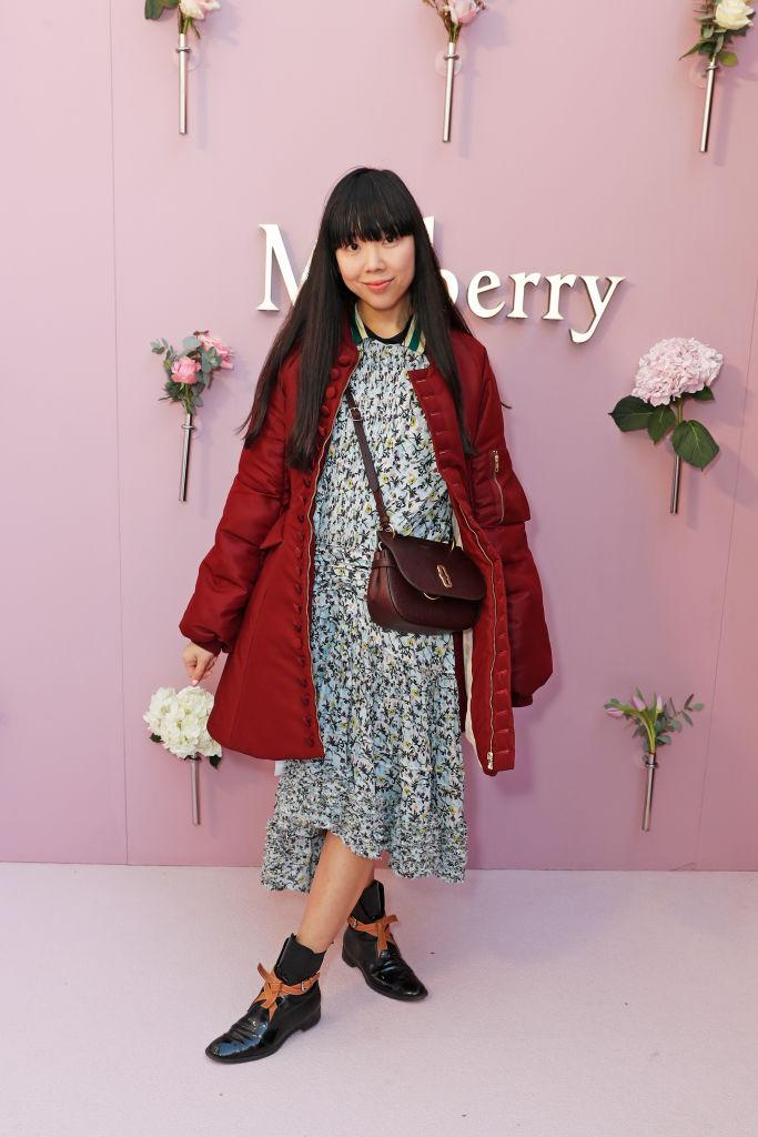<p>Susie Bubble wrapped up in a quilted jacket for the Mulberry SS18 show. <em>[Photo: Getty]</em> </p>
