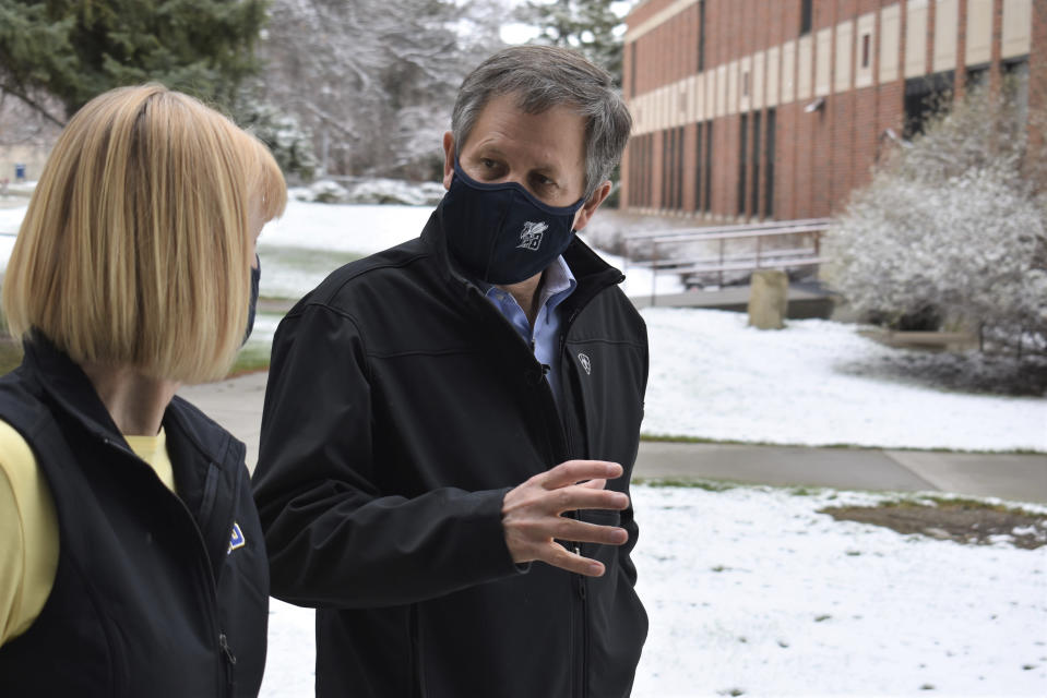 Montana Republican U.S. Sen. Steve Daines, right, speaks with Chancellor Stefani Hicswa on the campus of Montana State University Billings in Billings, Mont., on Friday, April 23, 2021. Daines says he has concerns with President Joe Biden's pick to lead the U.S. Bureau Land Management, Tracy Stone-Manning, over her ties to groups that aired campaign ads against him in the 2020 election. (AP Photo/Matthew Brown)