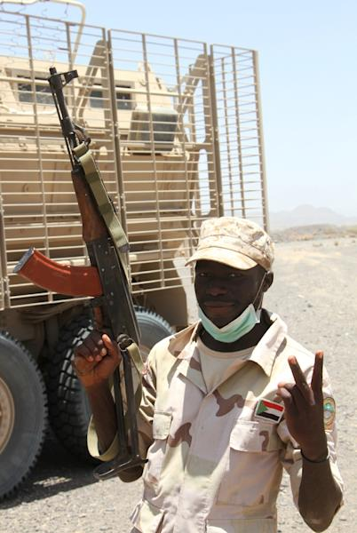 A Sudanese soldier flashes a victory sign outside the Yemeni coastal port town of Mokha (AFP Photo/SALEH AL-OBEIDI)