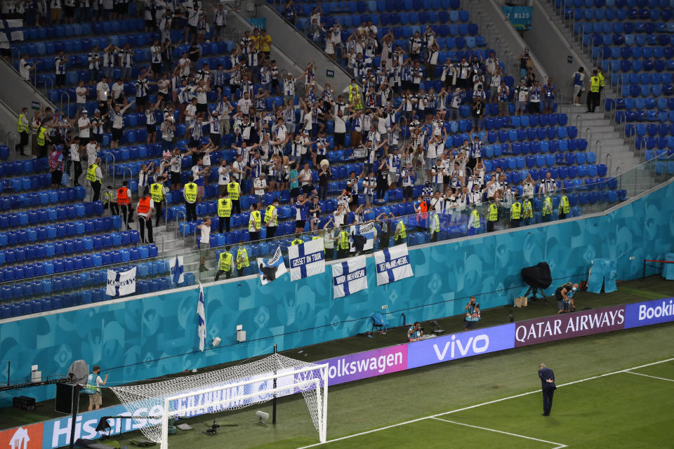 Finland's manager Markku Kanerva applauds fans at the end of the Euro 2020 soccer during the Euro 2020 soccer championship group B match between Finland and Belgium at Saint Petersburg Stadium in St. Petersburg, Russia, Monday, June 21, 2021. (Anton Vaganov/Pool Photo via AP)