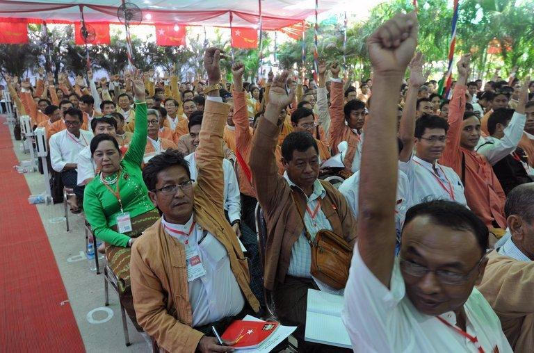 Delegates of the National League for Democracy gesture to vote during their party conference in Yangon on March 9, 2013