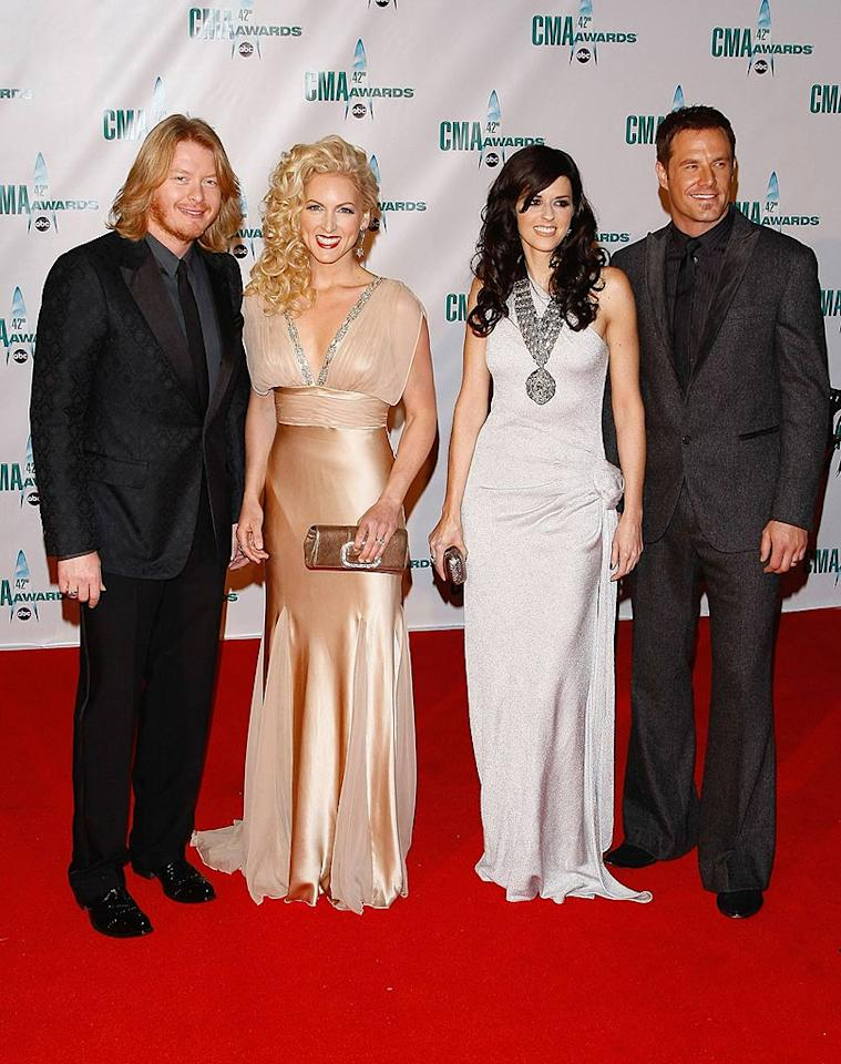 """Philip Sweet, Kimberly Roads, Karen Fairchild, and Jimi Westbrook of Little Big Town arrived in style. We're not sure what was bigger: Kimberly's hair or Karen's necklace! Jemal Countess/<a href=""""http://www.wireimage.com"""" target=""""new"""">WireImage.com</a> - November 12, 2008"""