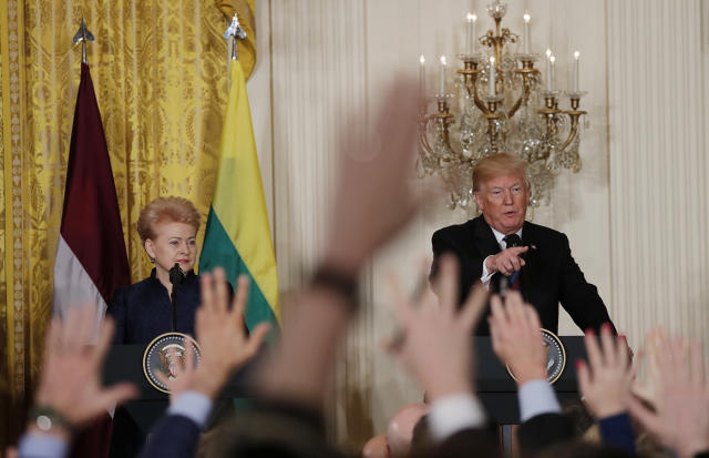 President Trump with Lithuania's President Dalia Grybauskaite on Tuesday. (Photo: Carlos Barria/Reuters)