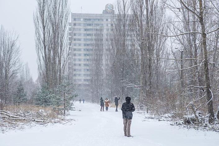 <p>People take pictures in the town of Pripyat (Getty Images) </p>