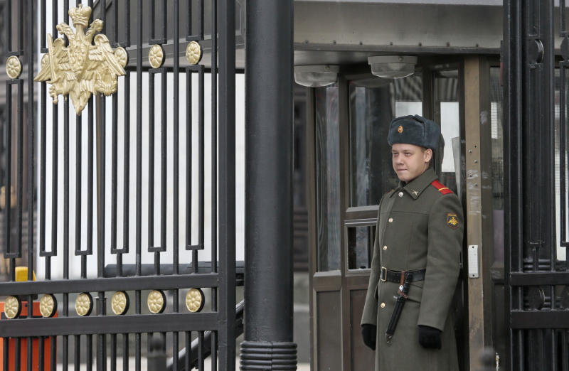 Russian soldier stands on duty at the entrance to the Russian Defense Ministry's headquarters in Moscow, Russia, Thursday, Oct. 25, 2012. Russia's top investigative agency has launched a criminal probe into alleged fraud linked to the sell off of the Defense Ministry's assets. (AP Photo/Mikhail Metzel)
