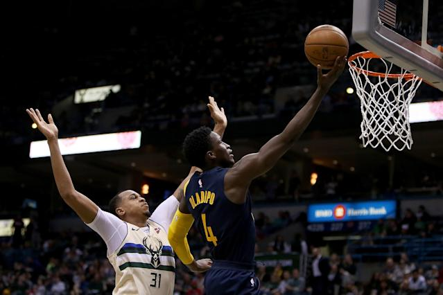 MILWAUKEE, WI - MARCH 02: Victor Oladipo #4 of the Indiana Pacers attempts a shot while being guarded by John Henson #31 of the Milwaukee Bucks in the third quarter at the Bradley Center on March 2, 2018 in Milwaukee, Wisconsin. (Photo by Dylan Buell/Getty Images)