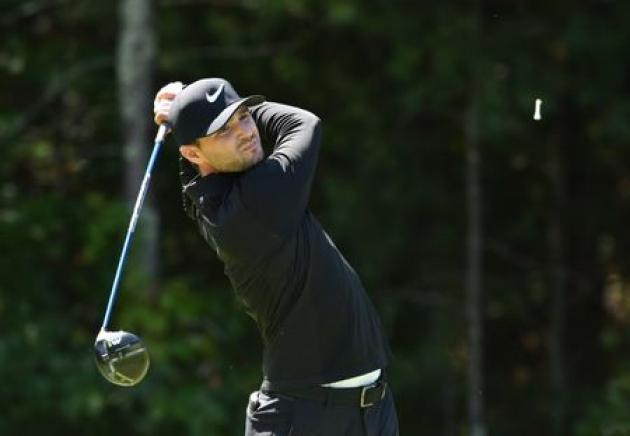 Golf: Stanley upstages big names to take Tour Championship lead