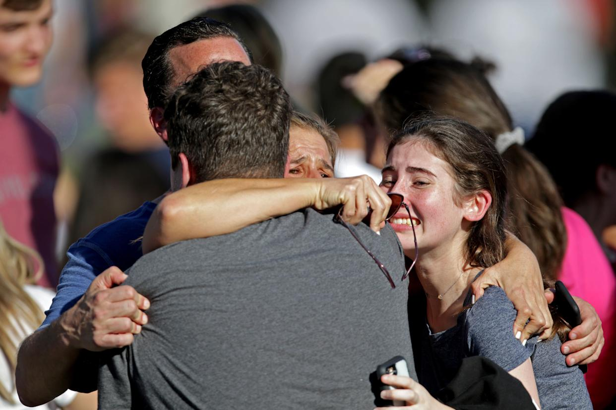 A family reunites outside of Stoneman Douglas High School.