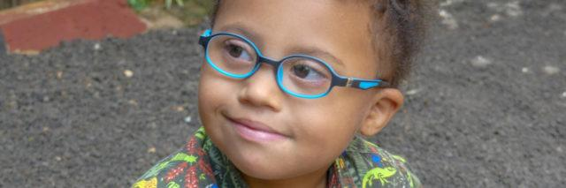 Hayley's son wearing blue glasses.