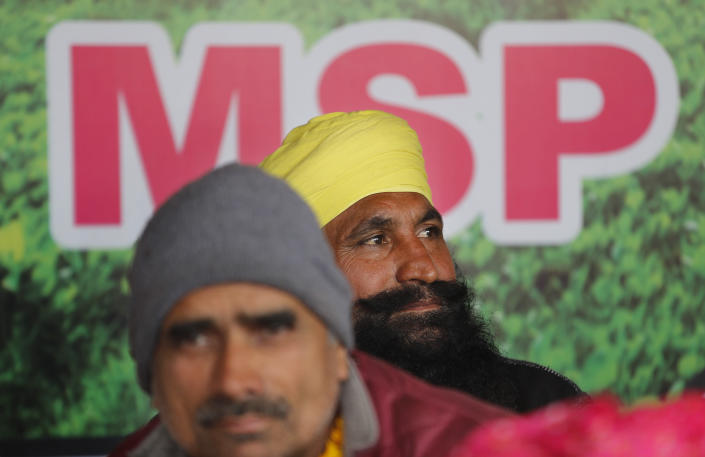Farmers participate in a day-long hunger strike to protest against new farm laws, at the Delhi-Uttar Pradesh border, on the outskirts of New Delhi, India, Saturday, Jan. 30, 2021. Indian farmers and their leaders spearheading more than two months of protests against new agriculture laws began a daylong hunger strike Saturday, directing their fury toward Prime Minister Narendra Modi and his government. Farmer leaders said the hunger strike, which coincides with the death anniversary of Indian independence leader Mahatma Gandhi, would reaffirm the peaceful nature of the protests. (AP Photo/Manish Swarup)