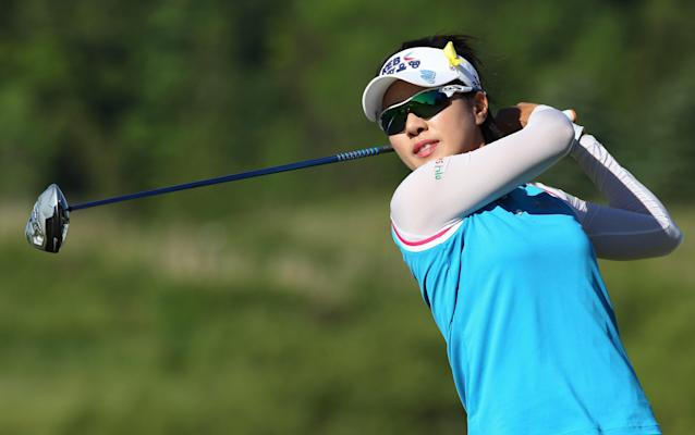 Last year's tournament winner Hee Young Park of South Korea hits a tee a shot on the way to shooting a 6-under par for a share of the at the Manulife Financial LPGA Classic Thursday, June 5, 2014 in Waterloo, Ontario. (AP Photo/The Canadian Press, Dave Chidley)