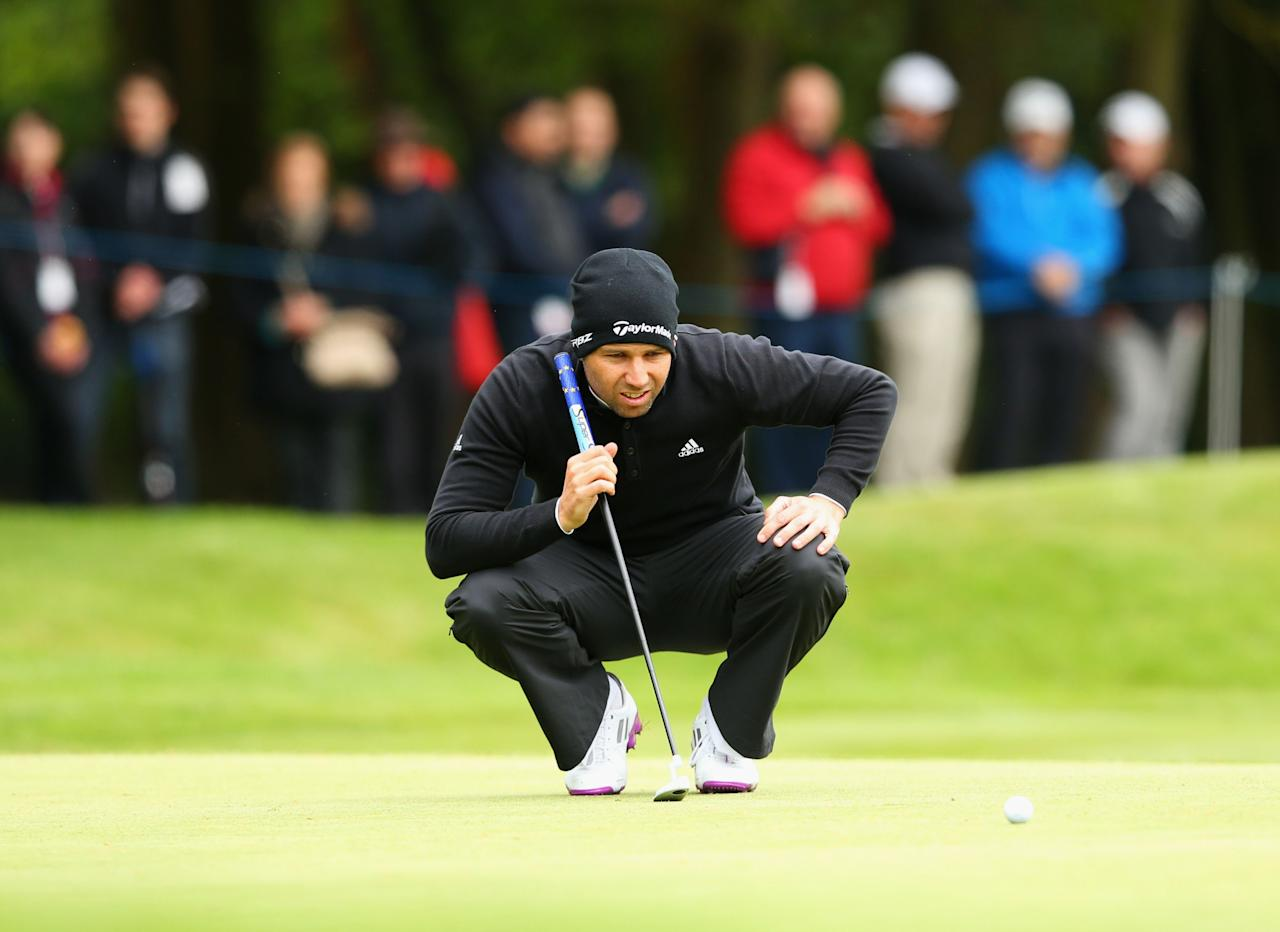 VIRGINIA WATER, ENGLAND - MAY 23:  Sergio Garcia of Spain lines up a putt during the first round of the BMW PGA Championship on the West Course at Wentworth on May 22, 2013 in Virginia Water, England.  (Photo by Julian Finney/Getty Images)