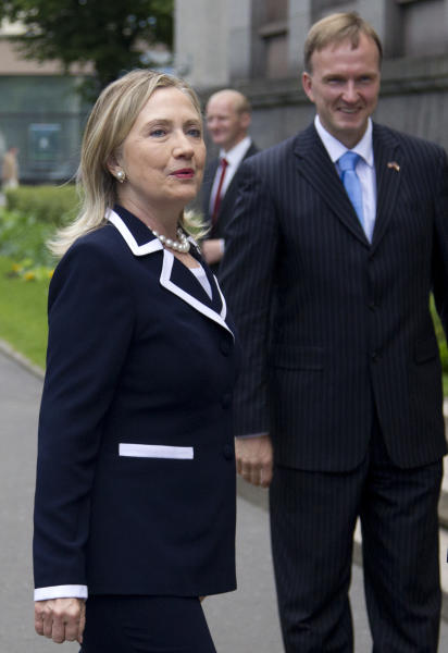 U.S. Secretary of State Hillary Rodham Clinton arrives for a meeting with Latvian Prime Minister Valdis Dombrovskis, Thursday, June 28, 2012, at the Council of Ministers in Riga, Latvia. (AP Photo/Haraz N. Ghanbari, Pool)