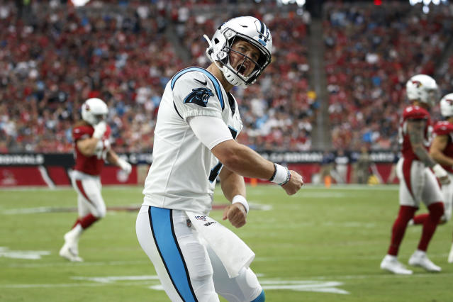 Carolina Panthers quarterback Kyle Allen (7) celebrates his touchdown pass against the Arizona Cardinals during the first half of an NFL football game, Sunday, Sept. 22, 2019, in Glendale, Ariz. (AP Photo/Ross D. Franklin)