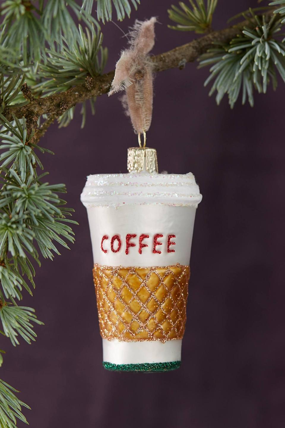 """<p>If you love coffee as much as the next person, this <a href=""""https://www.popsugar.com/buy/Go-Coffee-Glass-Ornament-502216?p_name=To%20Go%20Coffee%20Glass%20Ornament&retailer=anthropologie.com&pid=502216&price=28&evar1=casa%3Aus&evar9=46615300&evar98=https%3A%2F%2Fwww.popsugar.com%2Fhome%2Fphoto-gallery%2F46615300%2Fimage%2F46767574%2FTo-Go-Coffee-Glass-Ornament&list1=shopping%2Canthropologie%2Choliday%2Cchristmas%2Cchristmas%20decorations%2Choliday%20decor%2Chome%20shopping&prop13=mobile&pdata=1"""" rel=""""nofollow noopener"""" class=""""link rapid-noclick-resp"""" target=""""_blank"""" data-ylk=""""slk:To Go Coffee Glass Ornament"""">To Go Coffee Glass Ornament</a> ($28) is a must have.</p>"""