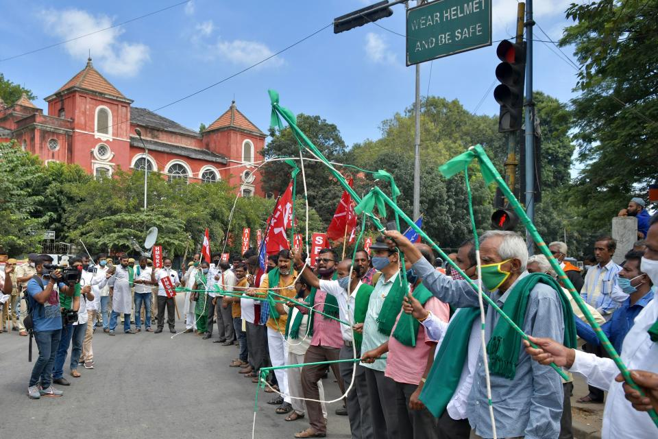 Farmers rights organisations stage a protest during a nationwide farmers' strike following the recent passing of agriculture bills in the Lok Sabha (lower house), in Bangalore on September 25, 2020. - Angry farmers took to the streets and blocked roads and railways across India on September 25, intensifying protests over major new farming legislation they say will benefit only big corporates. (Photo by Manjunath Kiran / AFP) (Photo by MANJUNATH KIRAN/AFP via Getty Images)