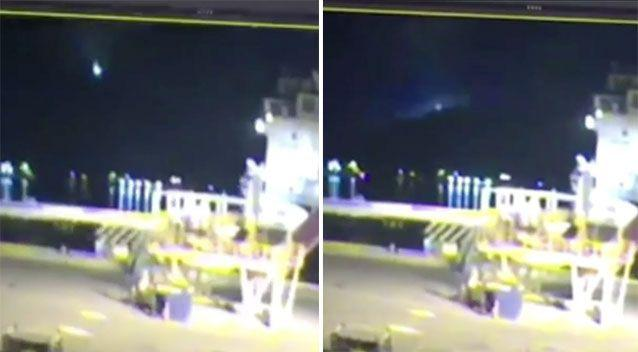 A bizarre flash of green light falling from the sky in Canada has been captured on video but no one is sure exactly what it is. Source: CBC News