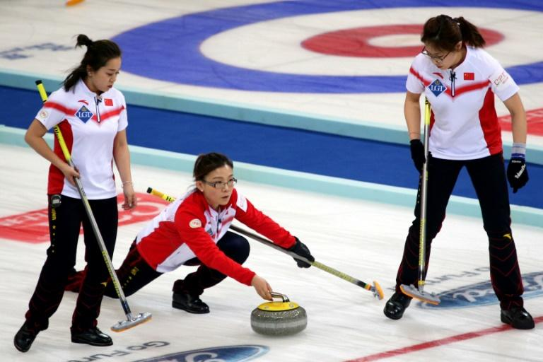 Curling sees athletes slide heavy, circular granite stones across a stretch of ice towards a target, with two sweepers wielding brooms rushing along in front in an attempt to influence its course