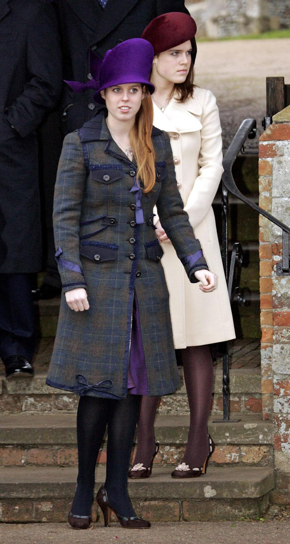 Princess Beatrice donned an unusual purple hat and matching coat in 2005, while her sister, Princess Eugenie, went for a nude coat and burgundy hat. Photo: Getty Images