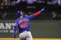 Chicago Cubs' Willson Contreras celebrates after hitting a two-run home run during the eighth inning of a baseball game against the Milwaukee Brewers Tuesday, April 13, 2021, in Milwaukee. (AP Photo/Morry Gash)