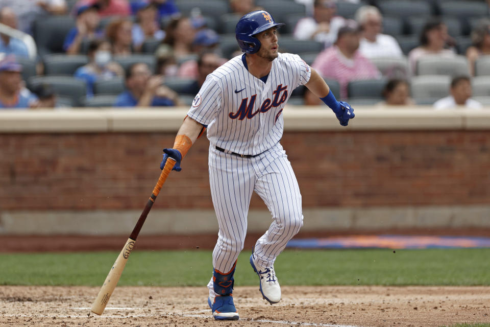 New York Mets' Jeff McNeil watches a two-RBI double in the sixth inning against the Toronto Blue Jays during a baseball game Sunday, July 25, 2021, in New York. (AP Photo/Adam Hunger)