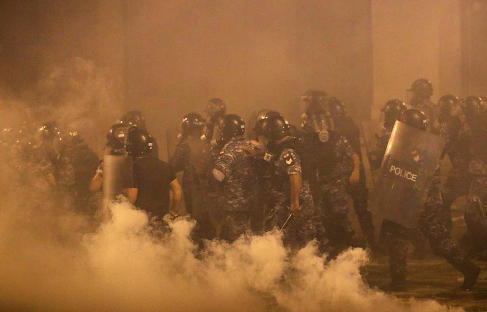 Police officers are seen during a Beirut protest days after the blastReuters
