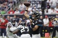 Jacksonville Jaguars quarterback Gardner Minshew (15) throws against the Houston Texans during the first half of an NFL football game Sunday, Sept. 15, 2019, in Houston. (AP Photo/David J. Phillip)