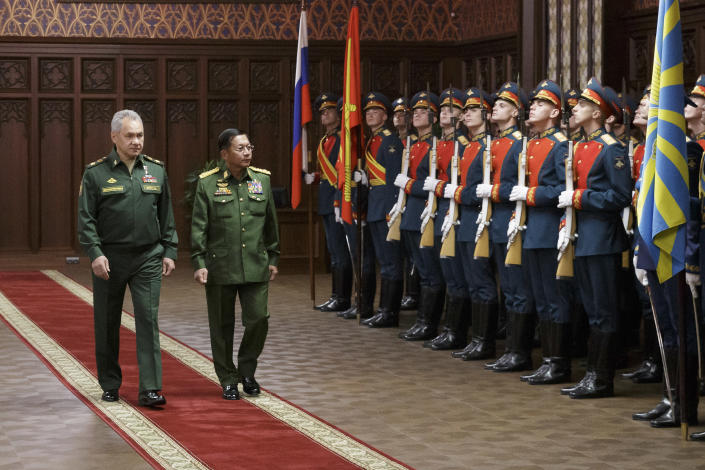 Russian Defense Minister Sergei Shoigu, left, and Commander-in-Chief of Myanmar's armed forces, Senior General Min Aung Hlaing walk past the honor guard prior to their talks in Moscow, Russia, Tuesday, June 22, 2021. (Vadim Savitskiy/Russian Defense Ministry Press Service via AP)