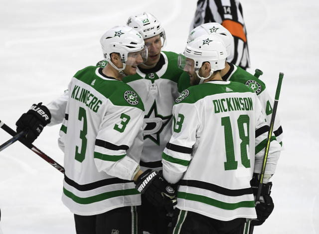 Dallas Stars defenseman John Klingberg (3) celebrates a goal against the Ottawa Senators with defenseman Esa Lindell (23), left wing Jamie Benn (14) and center Jason Dickinson (18) during the first period of an NHL hockey game Sunday, Feb. 16, 2020, in Ottawa, Ontario. (Justin Tang/The Canadian Press via AP)